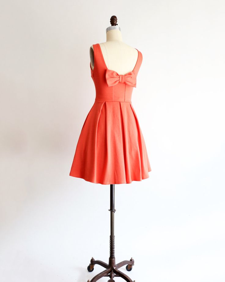 JANUARY | Coral bridesmaid dress with bow. vintage inspired cocktail dress. pleated skirt party dress. retro mod coral bridesmaids dress by ShopApricity on Etsy https://www.etsy.com/listing/252352901/january-coral-bridesmaid-dress-with-bow