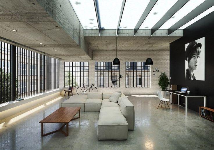 mur de brique blanche, plafond en béton et revêtement de sol aspect béton dans…