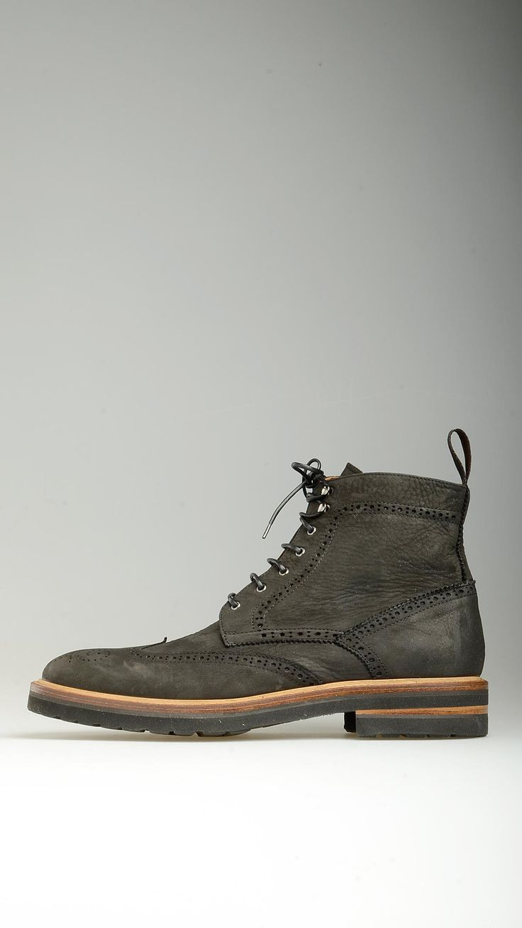 Black tumbled leather lace-ups ankle boots featuring round toe, 1.3'' heeled and 0.7'' of platform, brogues detailing cap toe and quarters, rubber soke, 100% leather.