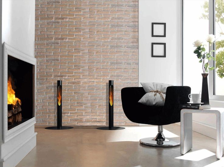 Niall | Creating a well-balanced contrast to textured walls and exposed brick surfaces, Niall torch is also designed as a mid-height ambient light source to complement surrounding fire features, armchairs and other living room and dining area features. (ach and Base and Fuel sold separately.)