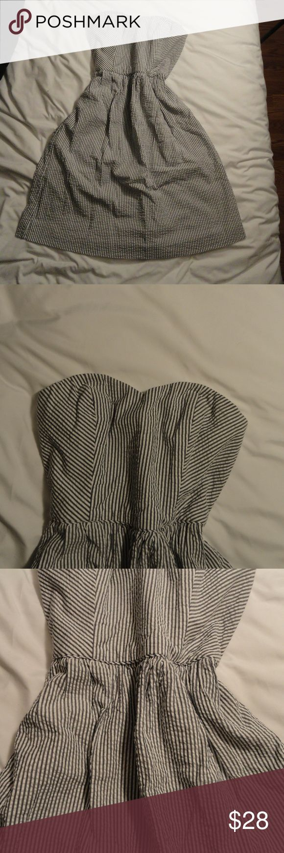 J. Crew - Mandy Dress - Seersucker Strapless Dress Super Adorable Seersucker Strapless Dress from J.Crew - Size 00 - Features a back zipper and fully lined.  Blue/Gray and White Striped.  100% Cotton Material both shell & Lining.  Fitted Bodice with boning for added support leads way to a looser fitting skirt.  Perfect for parties & summer!  Sweetheart neckline with grips to keep the dress in place.  A Line Silhouette that falls just above the knee J. Crew Dresses Strapless