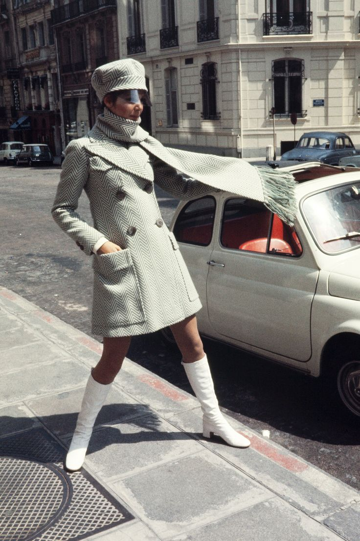60s white coat double breasted mod looks hat go go boots scarf In Photos: Vintage Paris Street Style  - HarpersBAZAAR.com
