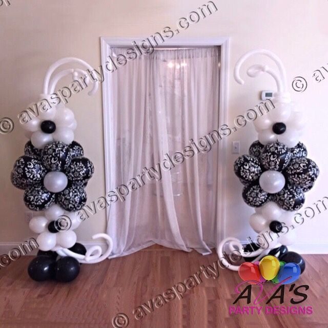 Up the elegance with theses Black and White Floral Pattern balloon columns