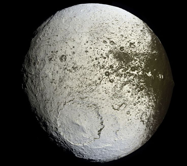 Saturn's Iapetus: Painted Moon-   Vast sections of this strange world are dark as coal, while others are as bright as ice. The composition of the dark material is unknown, but infrared spectra indicate that it possibly contains some dark form of carbon.  A leading hypothesis is that the dark material is mostly dirt leftover when relatively warm but dirty ice sublimates.