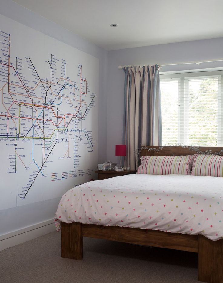 The iconic London Underground map makes a fabulous wall decal in this  bedroom.