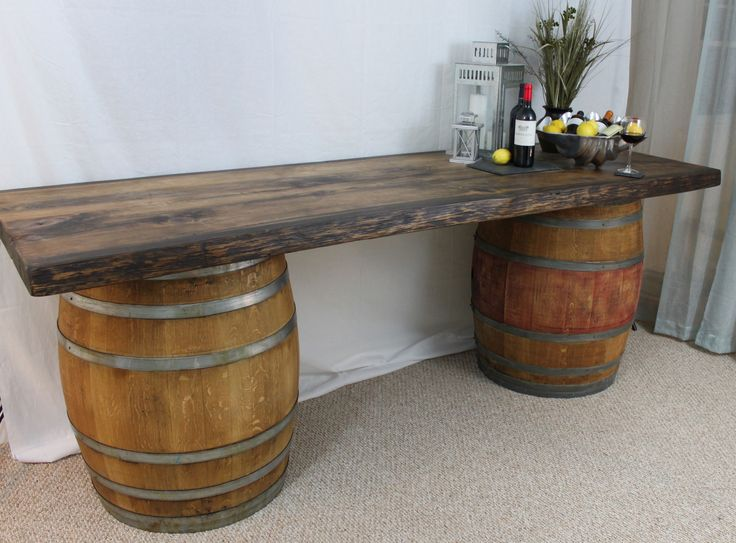 Two barrels topped with wood planks will create the beverage station