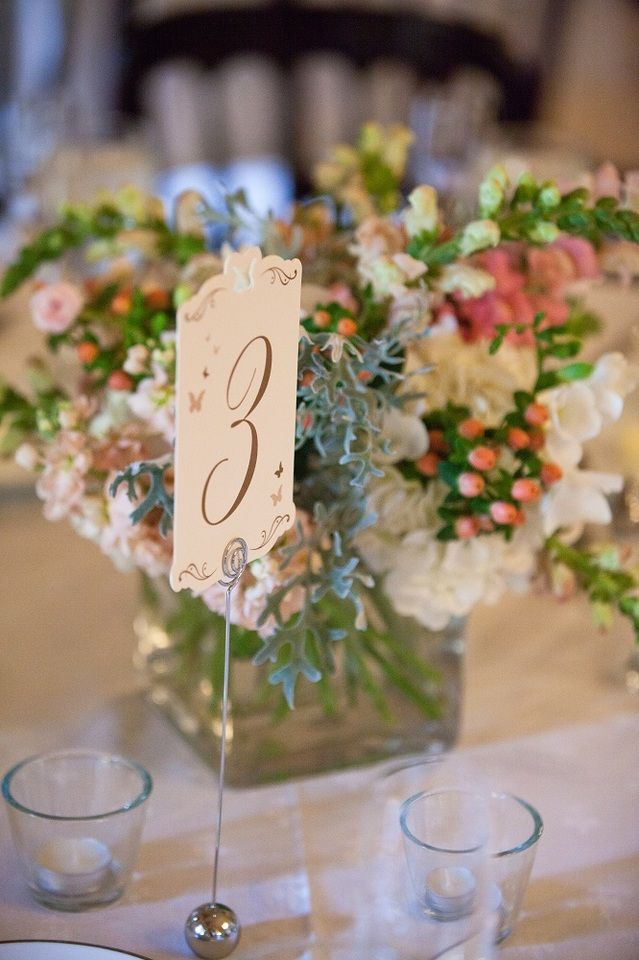 simple cream reception table numbers with gold lettering david de dios photography villasiena