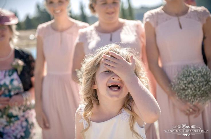 The flowergirl has a funny moment. Check out other wedding photography by Anthony Turnham at www.snapweddingphotography.co.nz