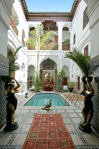 Moroccan real estate. If I go to morocco I'd like to stay someplace like that. Exotic homes. Pool