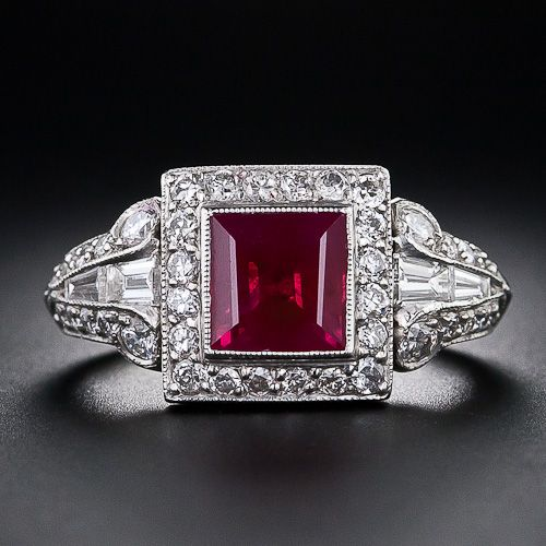 A ravishing, rich, red ruby (about as red as they come), weighing 1.75 carats, radiates from the center of this finely crafted platinum and diamond Art Deco ring.