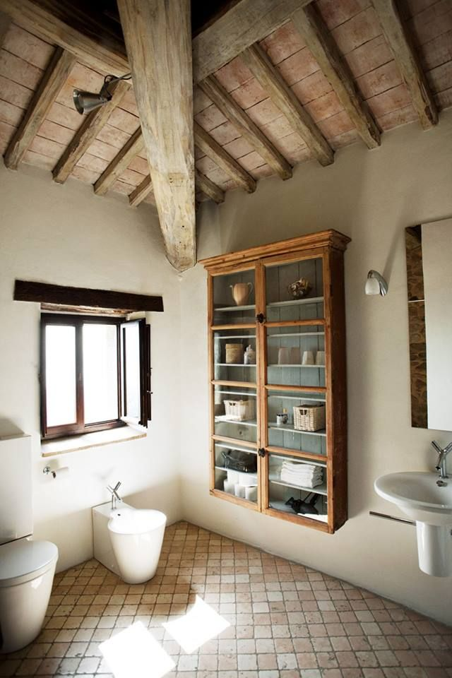 barn bathroom. open beam ceiling. stucco walls. floor free from built ins and sink. rustic. #1805|barn.plans.ideas