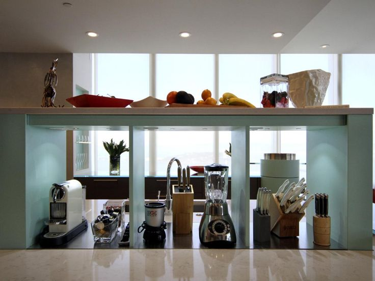 Small appliances and specialty knife blocks are tucked between behind-the-sink shelves in this contemporary kitchen.