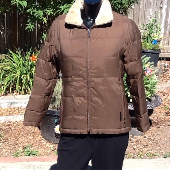 Brown coat Liz Claiborne Petite XS brown fur insid This is a great brown Liz Claiborne petite XS coat . Has fur on the inside. Dark brown on the outside and light brown on the inside. Front pockets and front zip. Inside has 2 inside pockets. My daughter wore if lucky 3 times. So great condition. Looks great . Nice winter coat. Liz Claiborne Jackets & Coats