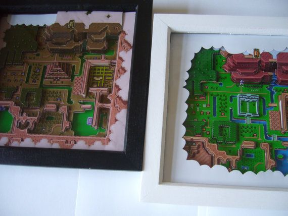 3D Art Diorama - Legend of Zelda Hyrule Map This is a hand crafted 3D Art Piece based on the Hyrule map from Legend of Zelda - A Link to the Past on the Super Nintendo -- you will get both versions of the map .. the light world and lso the transformed dark world  It is hand made in England ( by me! ) ... the wood frame measures 9 inches x 9 inches with a 1.5 inch depth, and has a glass frontage.  The map from Zelda is printed on high quality super glossy paper many times, and is precision…