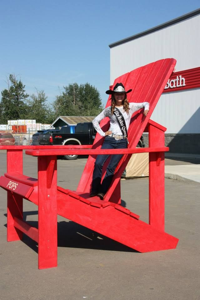 """Leann Peyre the """" High Prairie Elks Pro Rodeo Queen of 2014"""" on the BIG RED CHAIR."""