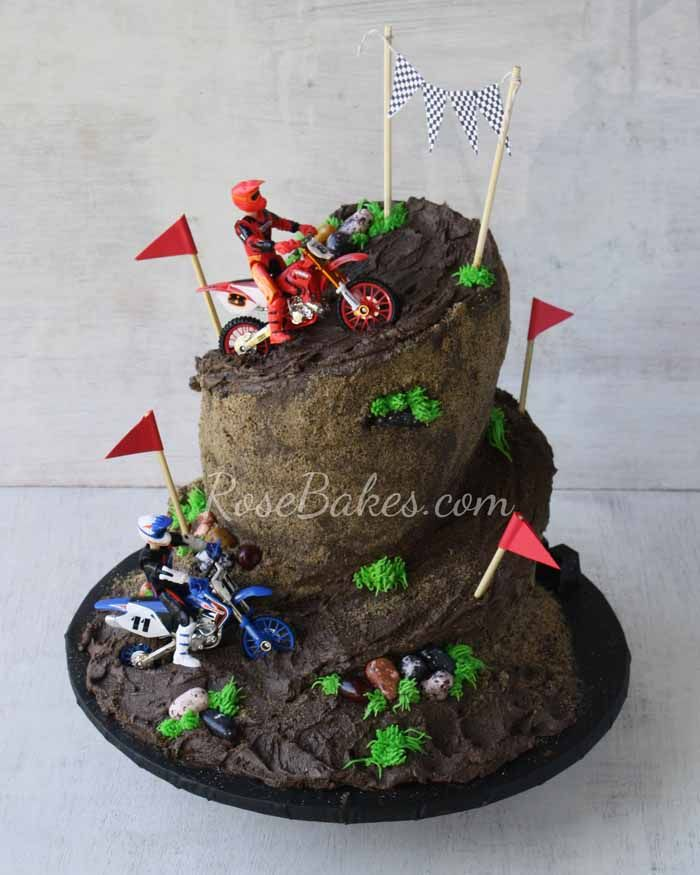Dirt Bike Racing Cake. See lots of pics and how I carved the cake to get this wonky shaped Dirt Bike Racing Cake.