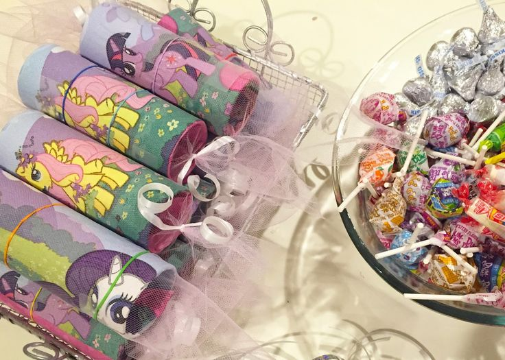 My Little Pony™ piñata party activity.  All you need to make these are craft rolls, party napkins, tulle, ribbons and candy.