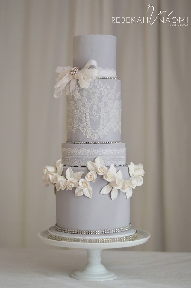 soft gray and white lace wedding cake with lace ribbon brooch bow