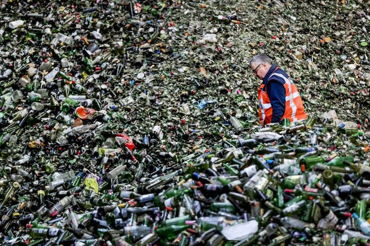 A mountain of bottles awaits processing at a glass recycling plant after Christmas and New Year's Eve celebrations, in Gameren, Netherlands; people wearing masks dance in a square amid heavy smog during a polluted day in Fuyang, Anhui province, China; and the sister of Elias Wardini, a Lebanese man who was killed in the New Year's Eve Istanbul nightclub attack, mourns as she holds her brother's portrait during his funeral procession in Beirut. These are just a few of the photos of the day…
