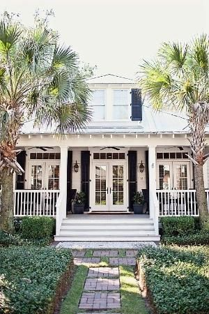 Southern-style architecture with French doors on either side of the front door. by spralet