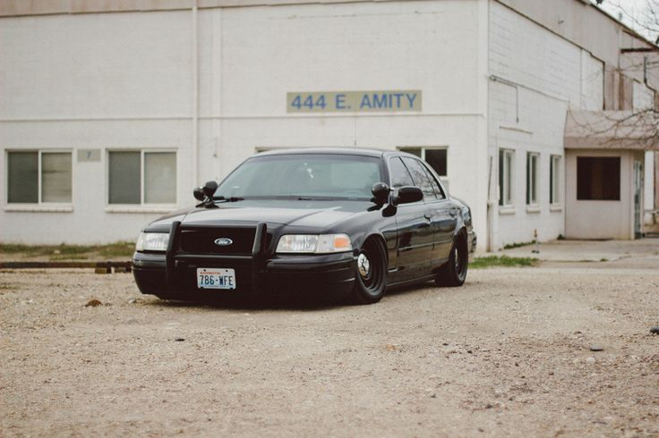Ford Crown Victoria Police Interceptor P71 slammed almost to the ground.