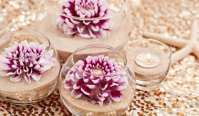 sand and flower wedding centerpieces