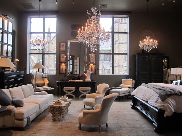 Bedroom at the Restoration Hardware store in Boston.  It has plenty of ideas for furniture placement in larger master bedrooms & what to do with awkward corners.