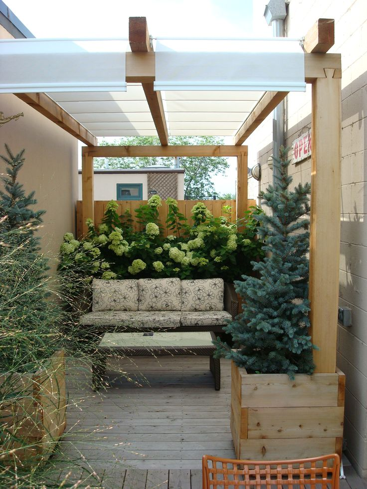 roof deck pergola retractable shade urban landscape garden design outdoor dining lounge deck
