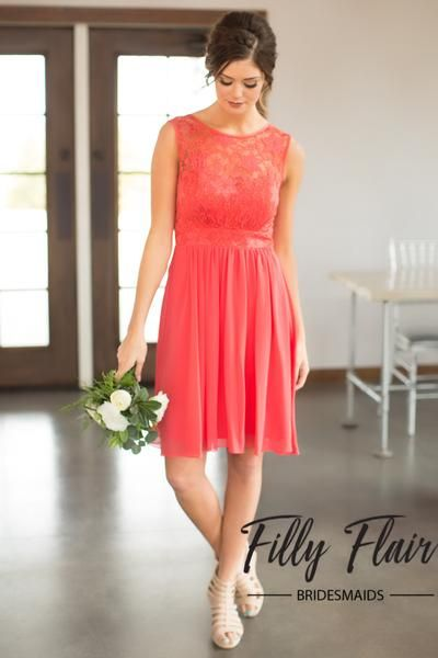 Add some playful details to your girl's bridesmaid dresses with this beautiful lace dress! This short bridesmaid dress features beautiful lace details across it's chest and subtle chiffon layers throughout it's short skirt. This is the perfect coral bridesmaid dress to choose for your wedding because it's timeless versatile, and affordable! Wear with a classic heel for a traditional look or pair with some western boots for a fun country wedding!  100% PolyesterLining 100% Pol...