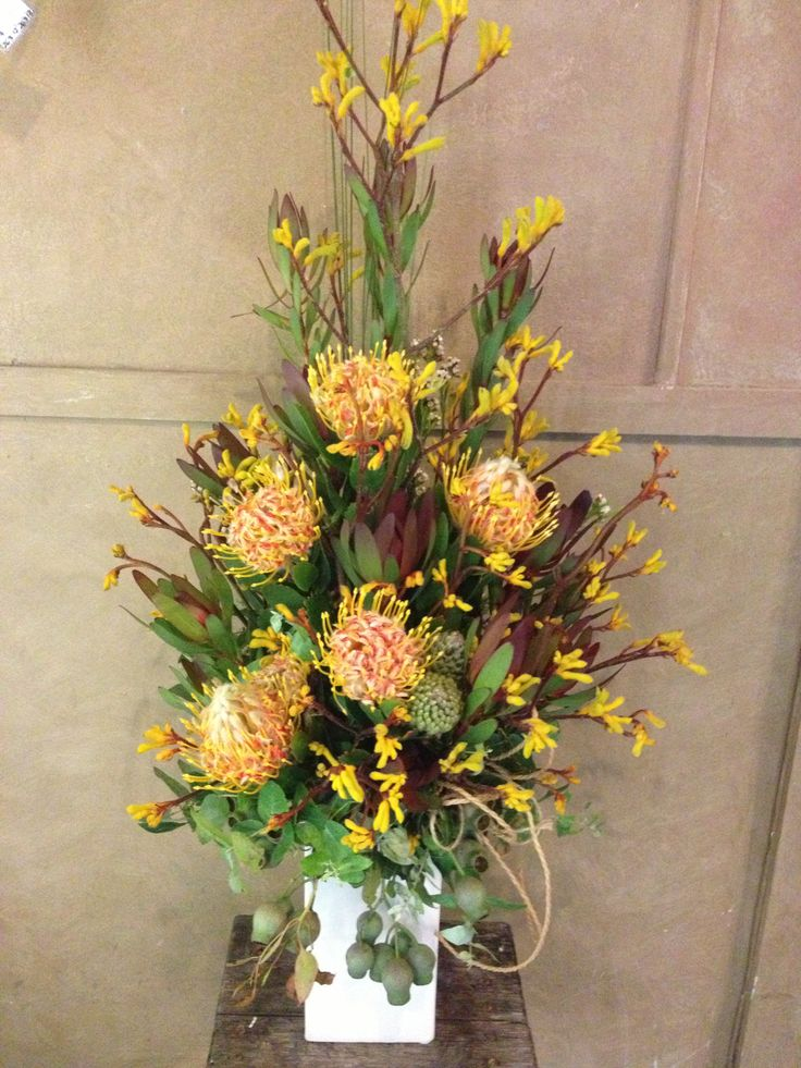 tall arrangements of bush blooms for buffet tables