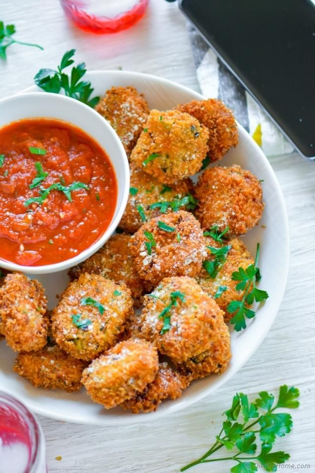Lasagna Bites, bite size spinach lasagna pieces, seasoned, breaded and fried, served with marinara dipping sauce for delicious summer movie-time snack. Whenever I have my friends and family coming...