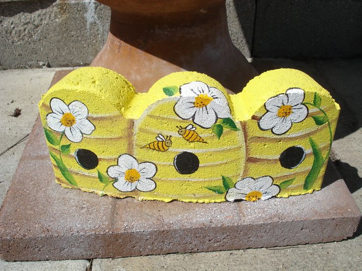 Painted Bee Hives on Scallop Concrete Edging - costs less than a dollar!