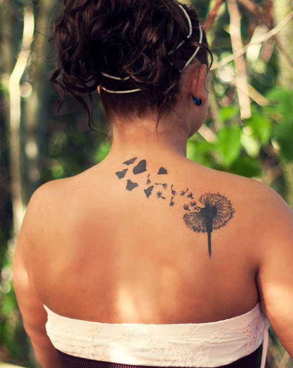 Nice dandelion shoulder tattoos designs fantastically done by artist.