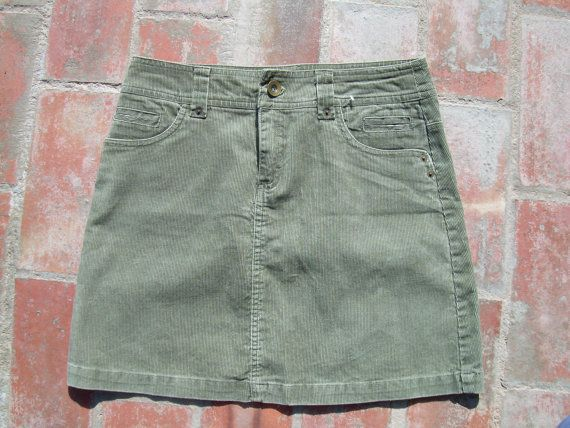 GREEN CORDUROY MINI Skirt , Kiabi in good vintage condition Washed measured flat  across top 14.5 across bottom 21 total length 16.5 please ask if you require more info or photos etc.. no problemo !  many other vintage clothes at https://www.etsy.com/shop/csclothes?ref=hdr_shop_menu