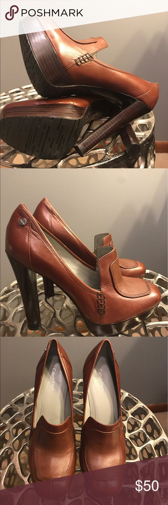 Beautiful Calvin Klein High Heeled Loafer NWOT- Calvin Klein cognac high heeled platform loafer. This shoe is only for those of you who truly know how to wear high heeled shoes. No amateurs allowed with this 4.5 inch heel. Shoe is in perfect condition and waiting for you. Calvin Klein Shoes Heels