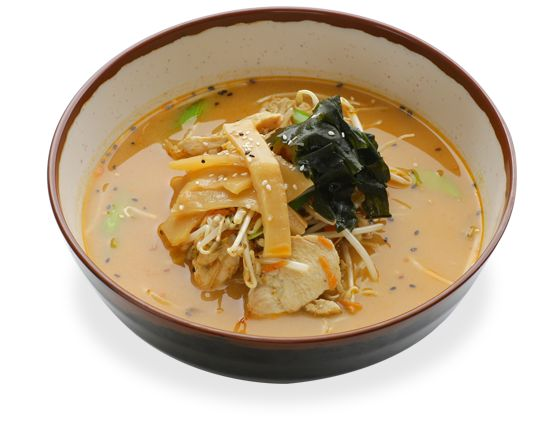 in a chicken spiced miso soup topped with stir-fried chicken, carrot ...