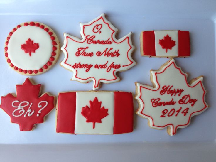 Sampling of my Canada Day 2014 sugar cookies...They even have red and white sprinkles in the dough! Used a homemade stencil for the maple leaves on the flags. The stencils turned out better than the RI transfers, and were MUCH quicker to make.
