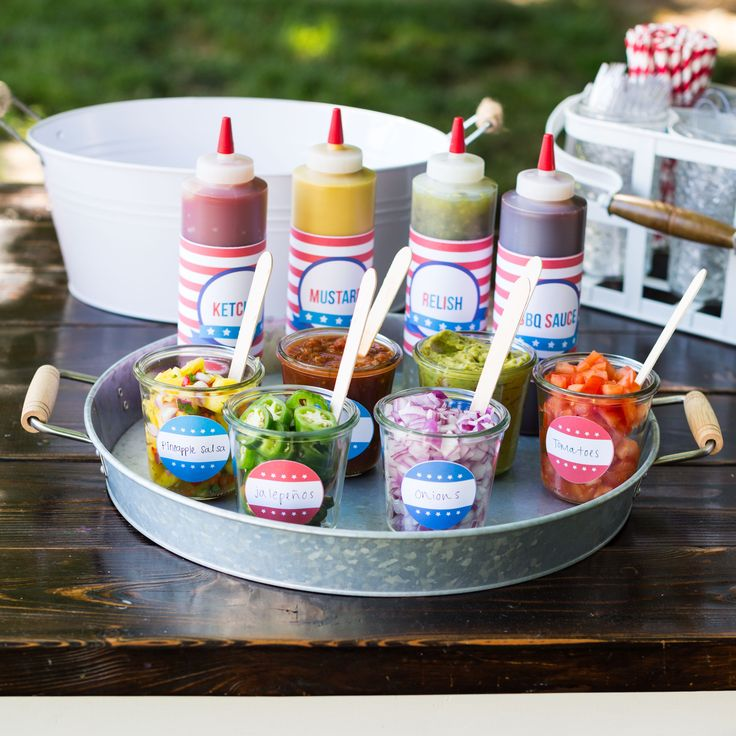 Hot Dog Toppings Bar for the 4th of July - the perfect way to celebrate with friends and family. Easy, free printables to help make your next BBQ a hit!