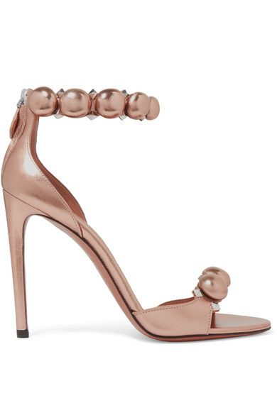 Azzedine Alaïa says the original supers Naomi Campbell, Cindy Crawford and Linda Evangelista helped define his label's glamorous aesthetic. Crafted with a vertiginous heel, these elegant sandals have been expertly made in Italy from rose gold leather. They're detailed with gunmetal pyramid studs and signature buttoned straps - each sphere is covered and placed by hand.