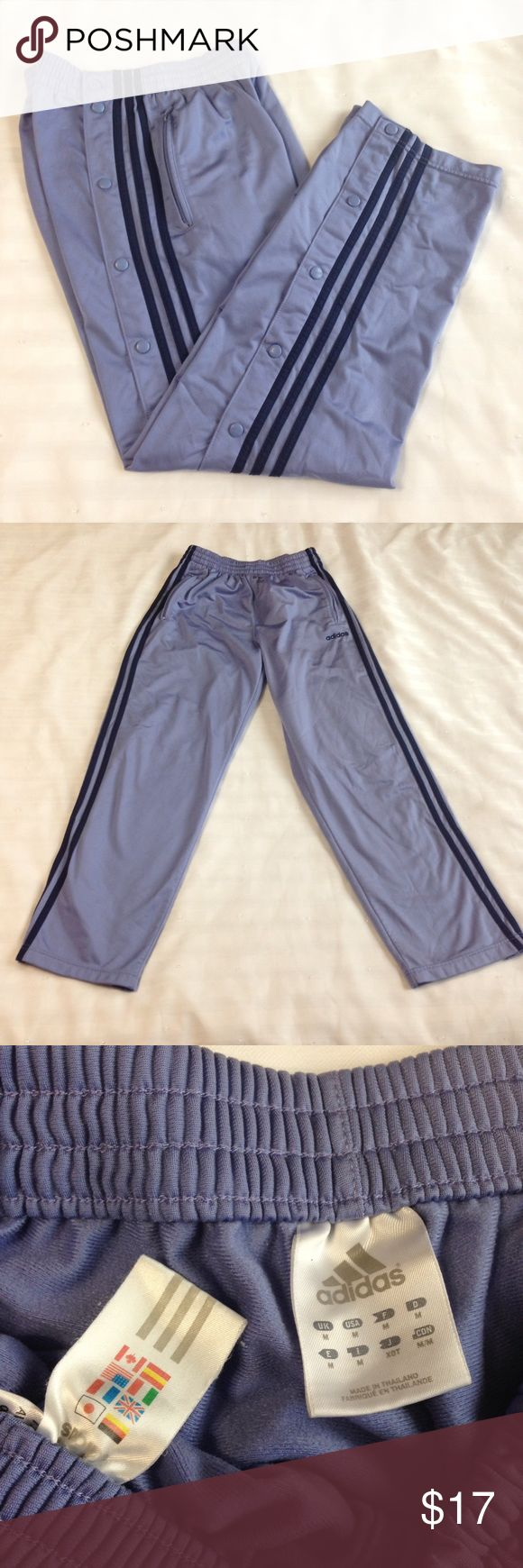 "🔮Women's Adidas purple track pants / sweatpants🔮 Women's Adidas purple track pants, sweatpants, running etc  Only flaw, it has a barely noticeable beige stain in the back as shown in 4th photo, that's why I have them at this low price, overall in very good preowned condition. Size M Medium, Button-up side closure. Two front zip pockets. There side stripes.  Reference RN # 88387 / CA # 40312  Measurements: Waist - appx 26"" All-around measured with the elastic unstreched. Inseam - appx 29…"