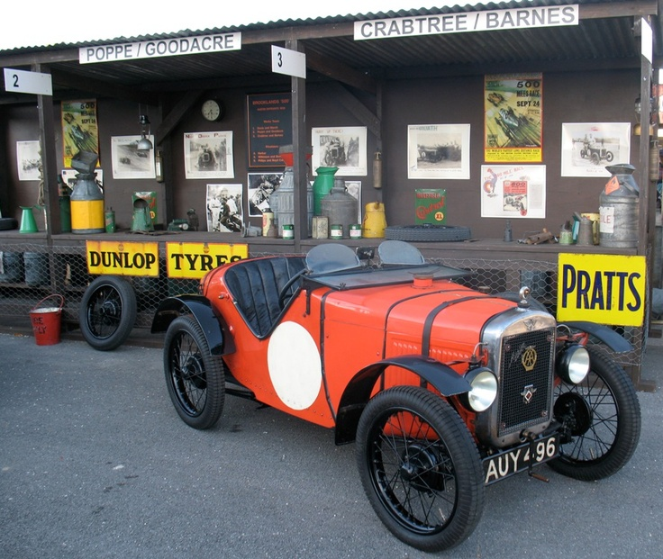 love this Austin 7 and the vintage signs via classictrackracing.com