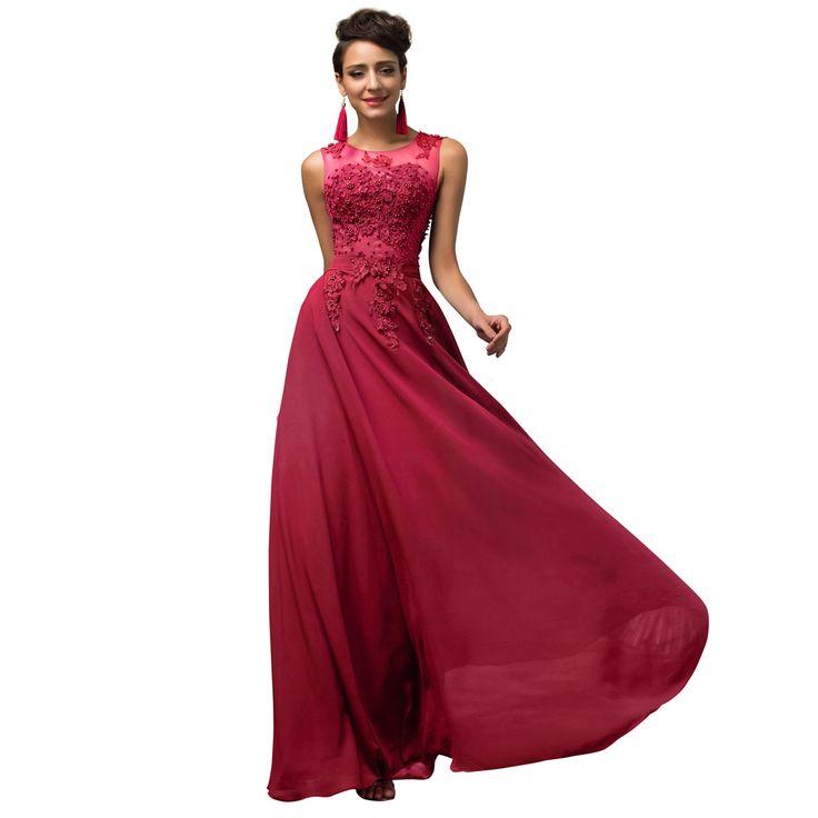Prachtige rode lange jurk met rok van organza en top bewerkt met kant en kralen. Voorzijde.