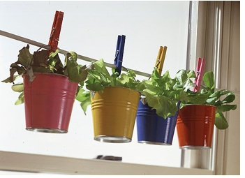These seems like a great way to have a windowsill garden if your window sill is too shallow to hold the pots.  Plus I love the colors.