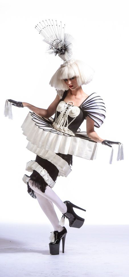 Paper artist Stuart McLachlan's unique creation praises the wacky fashion on display at World of WearableArt...