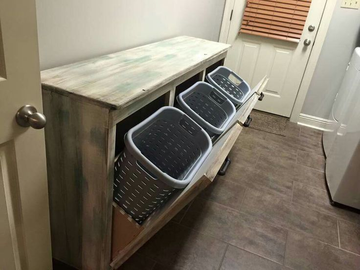 Genius way to store laundry! Fold on top & store those unsightly baskets underneath!! #laundryroom #makeover