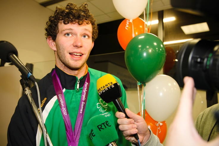 Irish Paralympian Darragh McDonald, who won swimming gold in the S6 400 metre freestyle, speaks to the waiting media at Dublin Airport on his return from the Games on Monday, September 10.