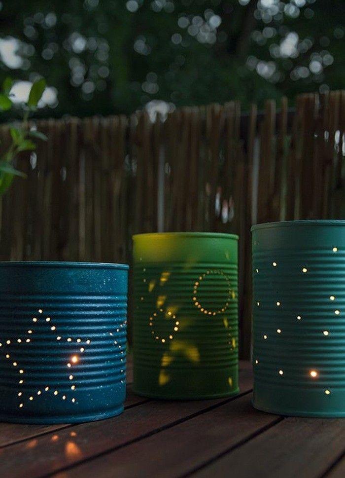 lanterne-realizzate-fai-da-te-barattoli-latta-colore-verde-blu-incise-stelle-buchi-cerchi