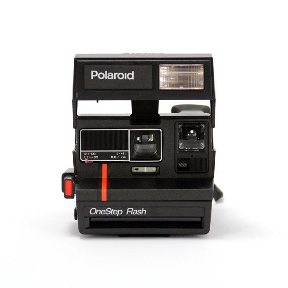 Vintage Polaroid One Step Flash camera. I want one of these sooo freakin bad! :D