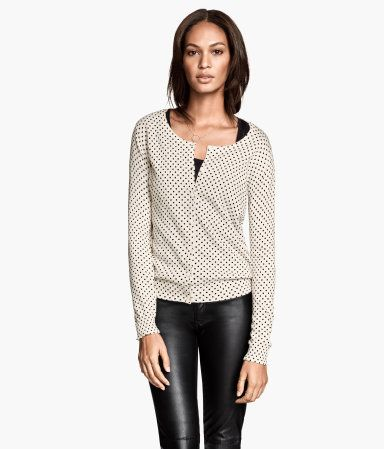 H&M: White Cardigan with black polka dots.