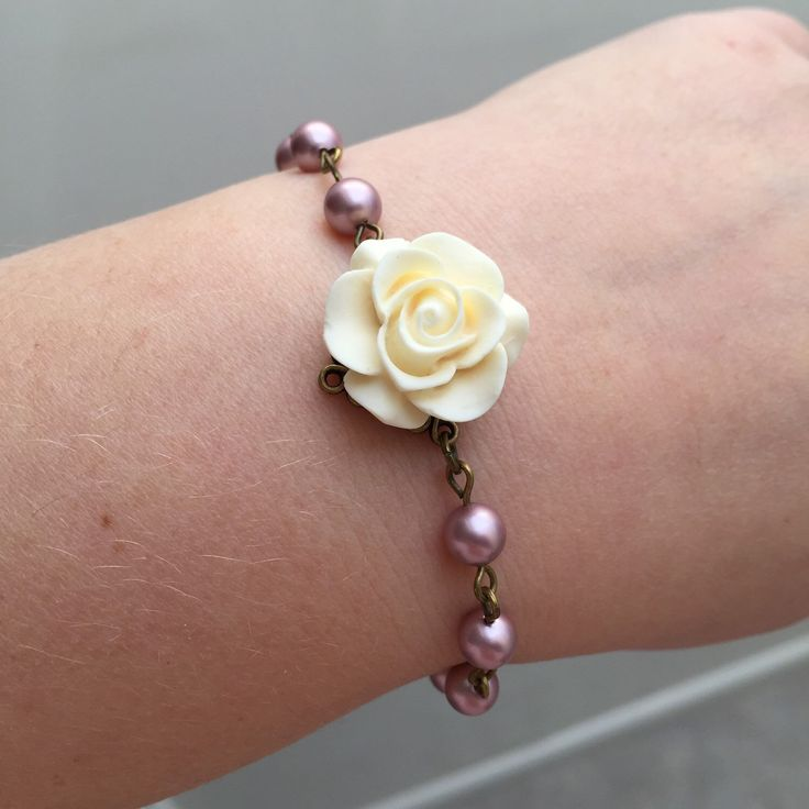 A personal favorite from my Etsy shop https://www.etsy.com/listing/232095660/may-sale-pink-pearl-bracelet-with-ivory